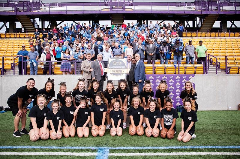 girls cheerleading and a CDTA award