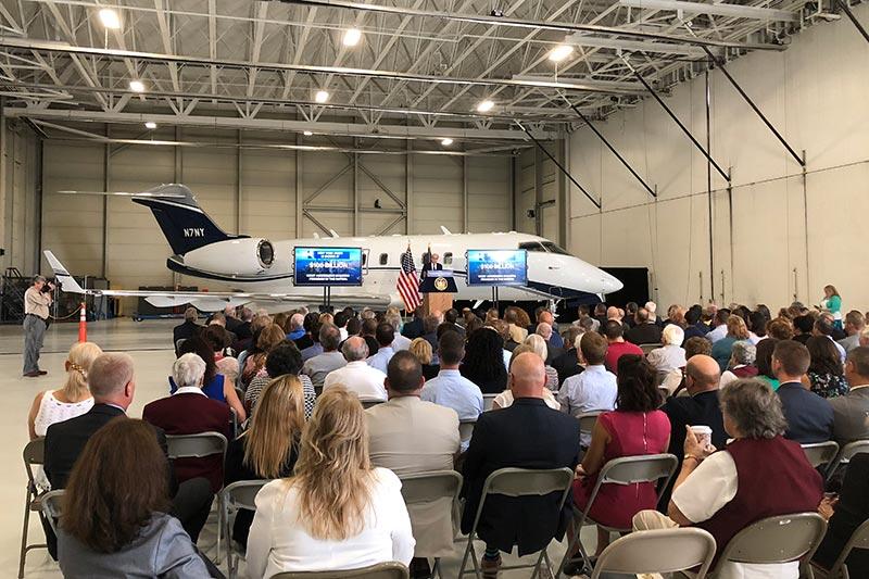 presentation in an airplane hangar