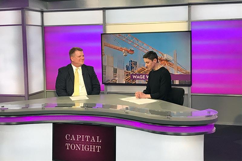 Capital Tonight newsroom with 2 people