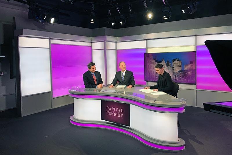 Capital Tonight newsroom with 3 people