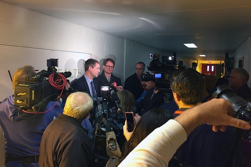 camera crews interviewing a man